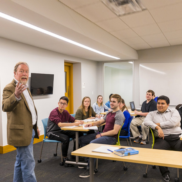 Prospective students meeting in a Macalester classroom.
